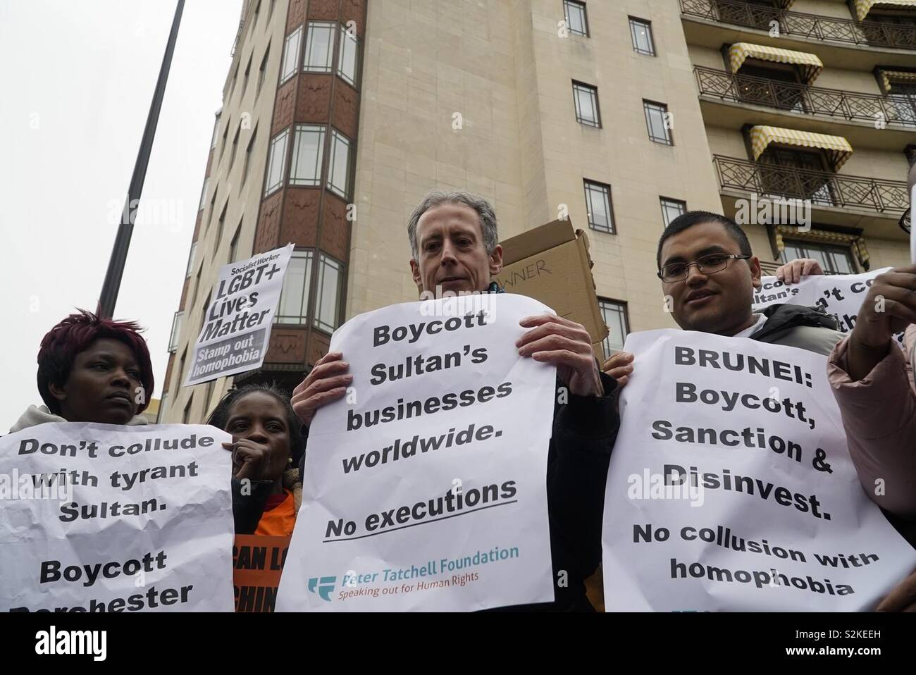 Peter Tatchell leads the protest outside the Dorchester Hotel London condemning recently introduced Brunei laws . - Stock Image