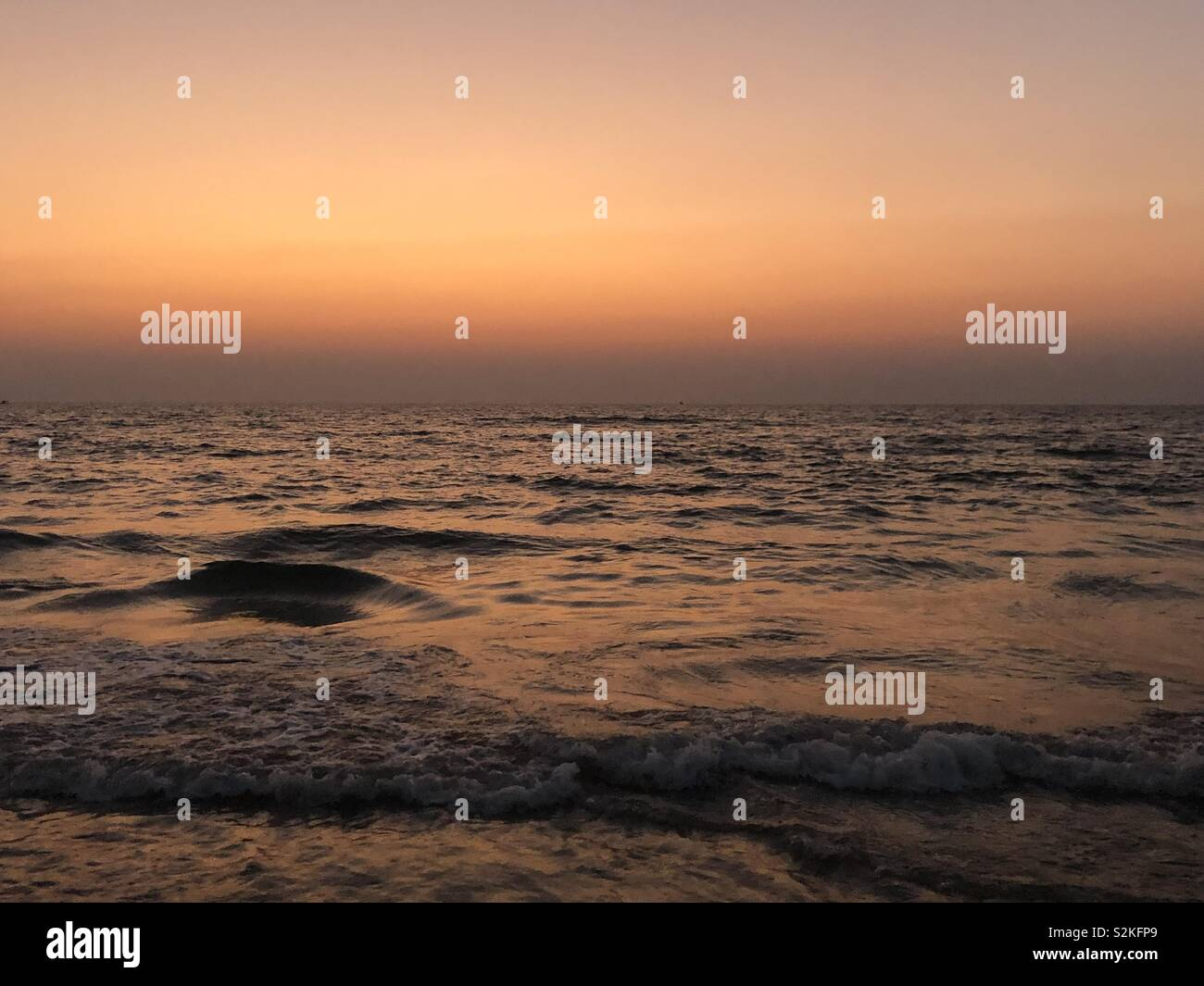 Dramatic evening by the water - Stock Image