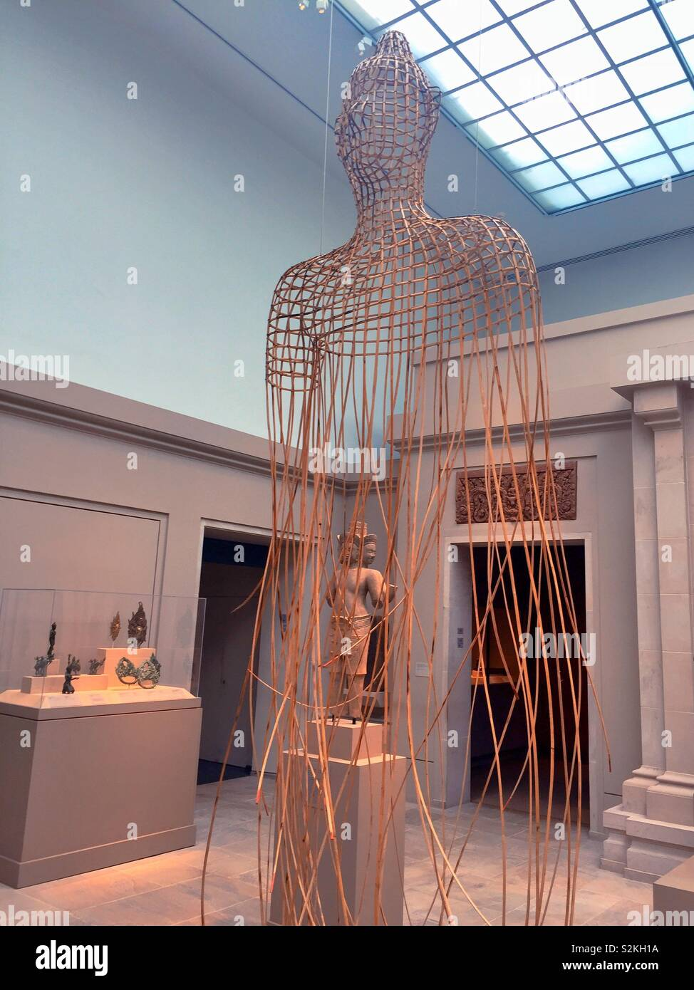 A rattan and wire Buddha sculpture in the Asian art galleries in the Metropolitan Museum of Art, NYC, USA Stock Photo