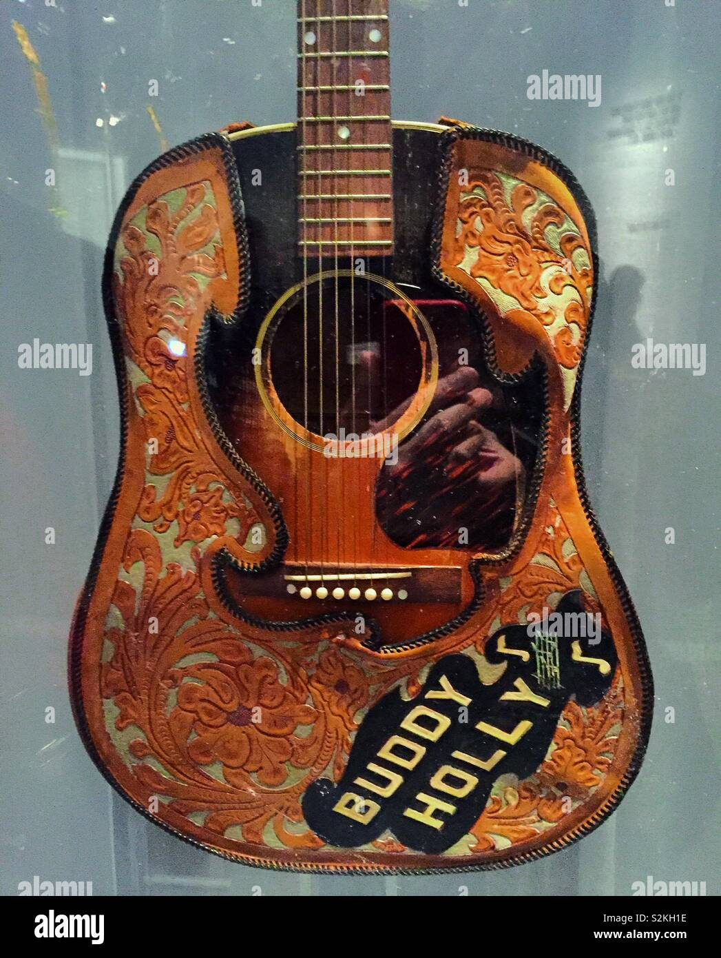 Acoustic guitar belonging to Buddy Holly with tooled leather cover, Metropolitan Museum of art, instruments of rock 'n' roll, NYC, USA - Stock Image