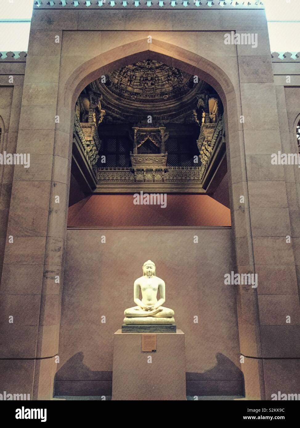 A white Buddha statue in the Asian Art wing of the Metropolitan Museum of Art, NYC, USA Stock Photo