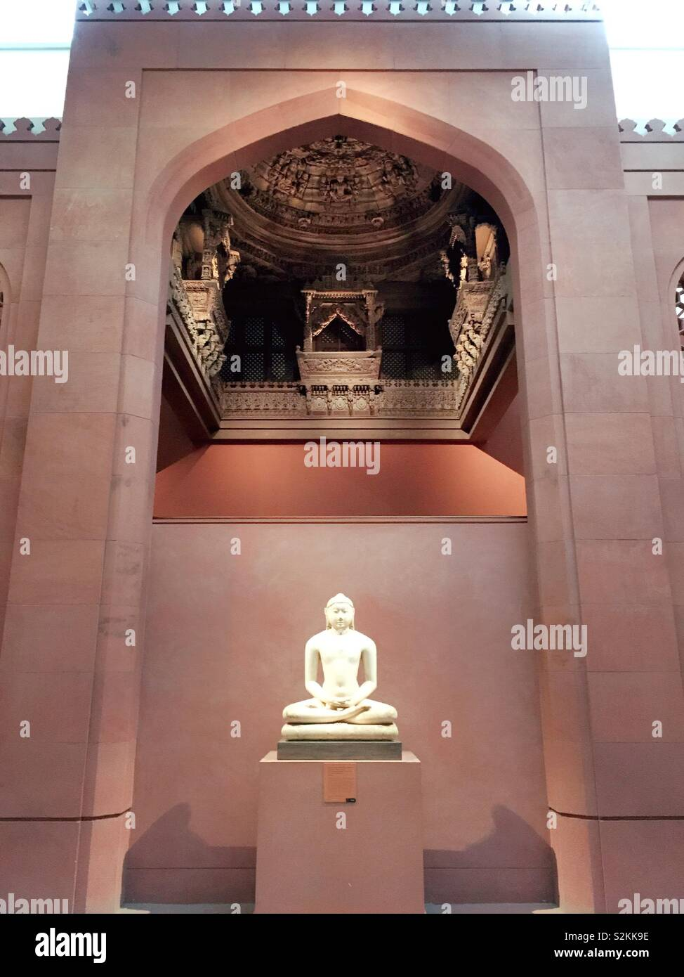 Buddha statue in the Asian art wing of the Metropolitan Museum of Art, NYC, USA - Stock Image