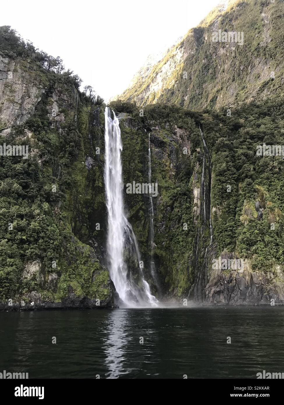 Waterfall in Milford Sound, New Zealand - Stock Image