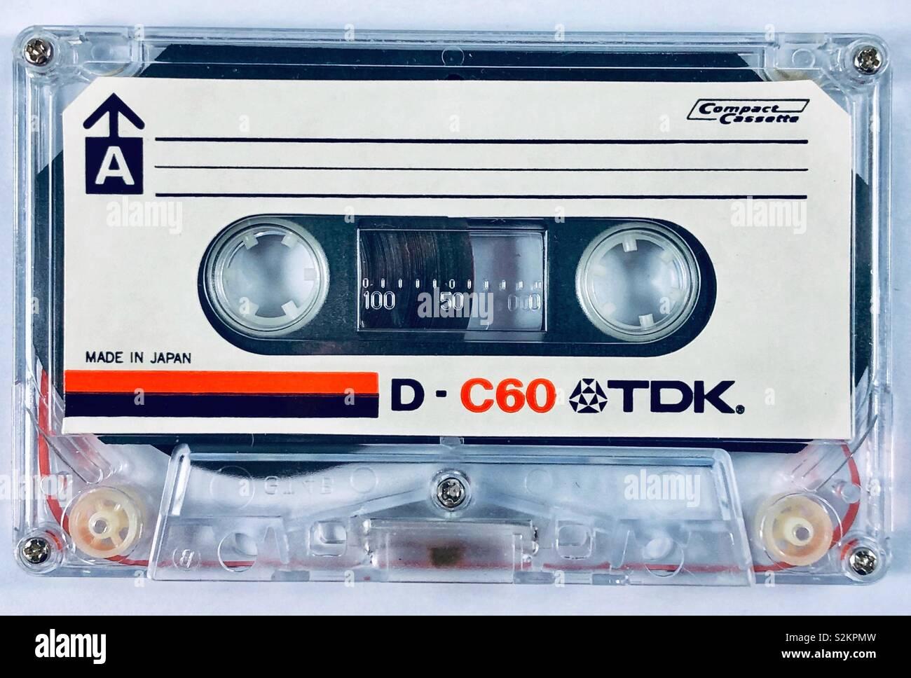 TDK D-C60 true mechanism clear case audio compact cassette. - Stock Image