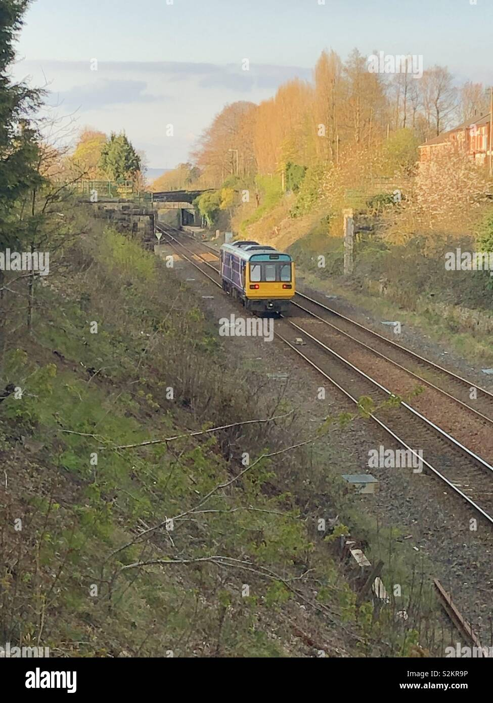 Class 142 approaches Woodley, Stockport - Stock Image