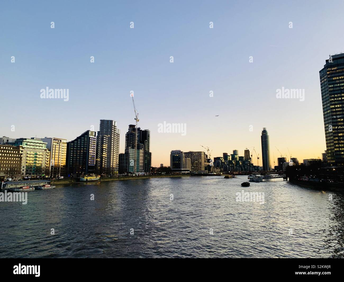 London Vauxhall's urban riverside cityscape with the government's MI6 headquarters (from James Bond) in the background. No commercially branded buildings visible - Stock Image