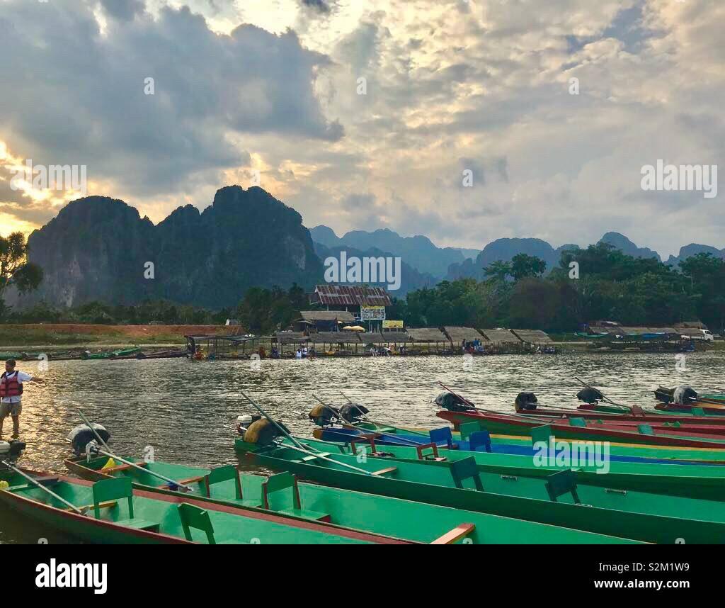 Boats on river at Vang Vieng Laos Stock Photo