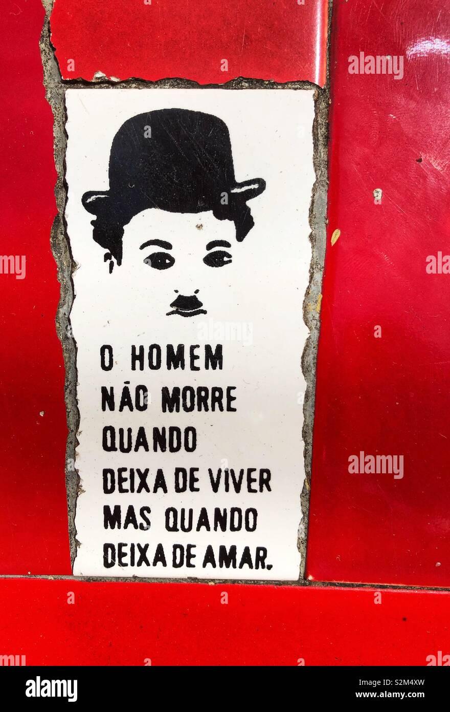 Portuguese language on a red and white ceramic tile in Rio de Janeiro, Brazil. Stock Photo