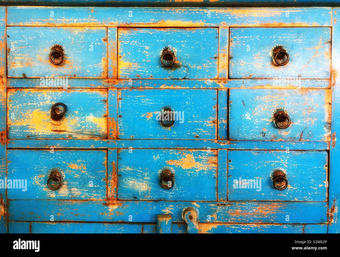Blue painted drawers - Stock Image