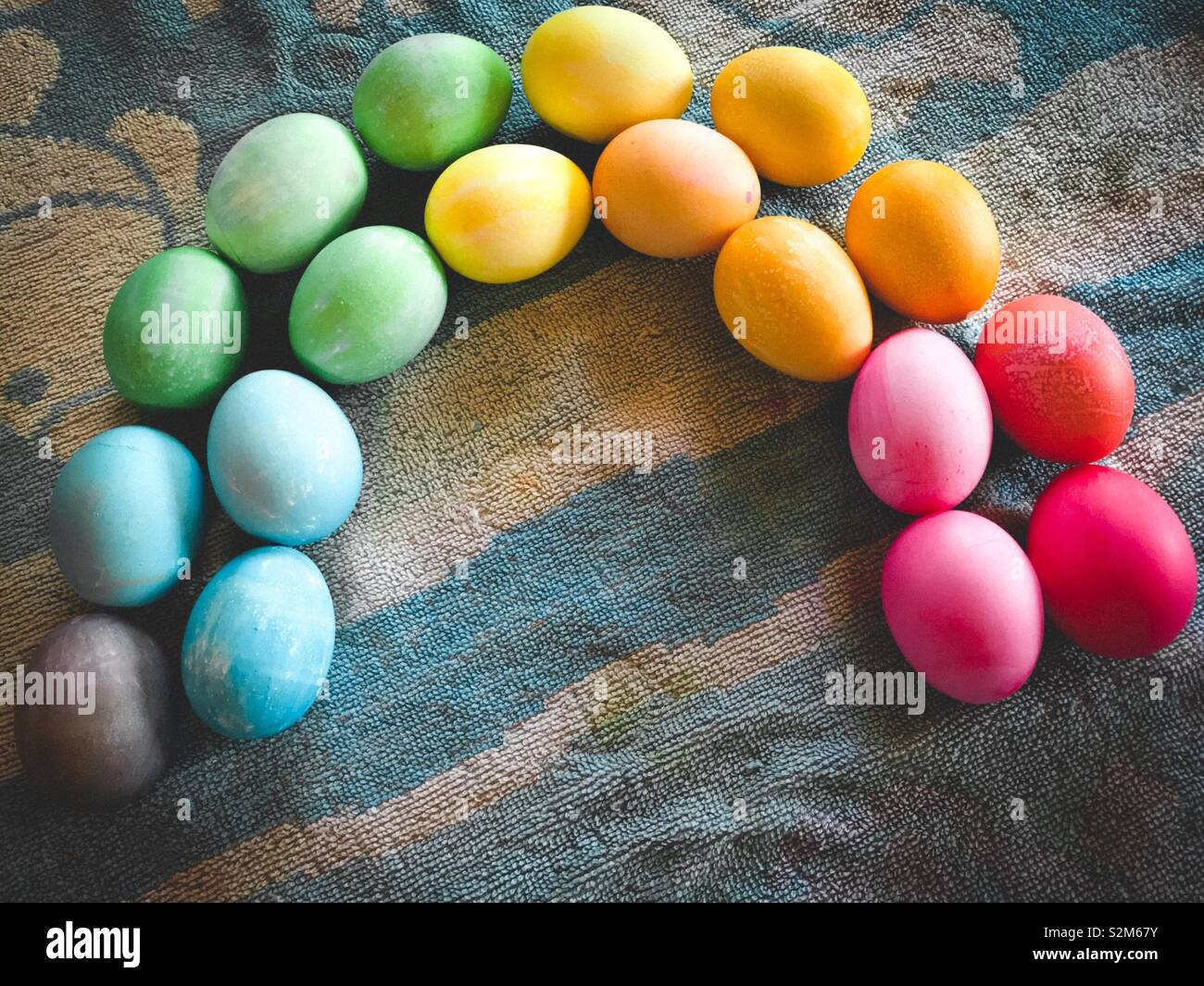 Colorful Easter eggs arranged into a rainbow- symbol of promise and rebirth - Stock Image