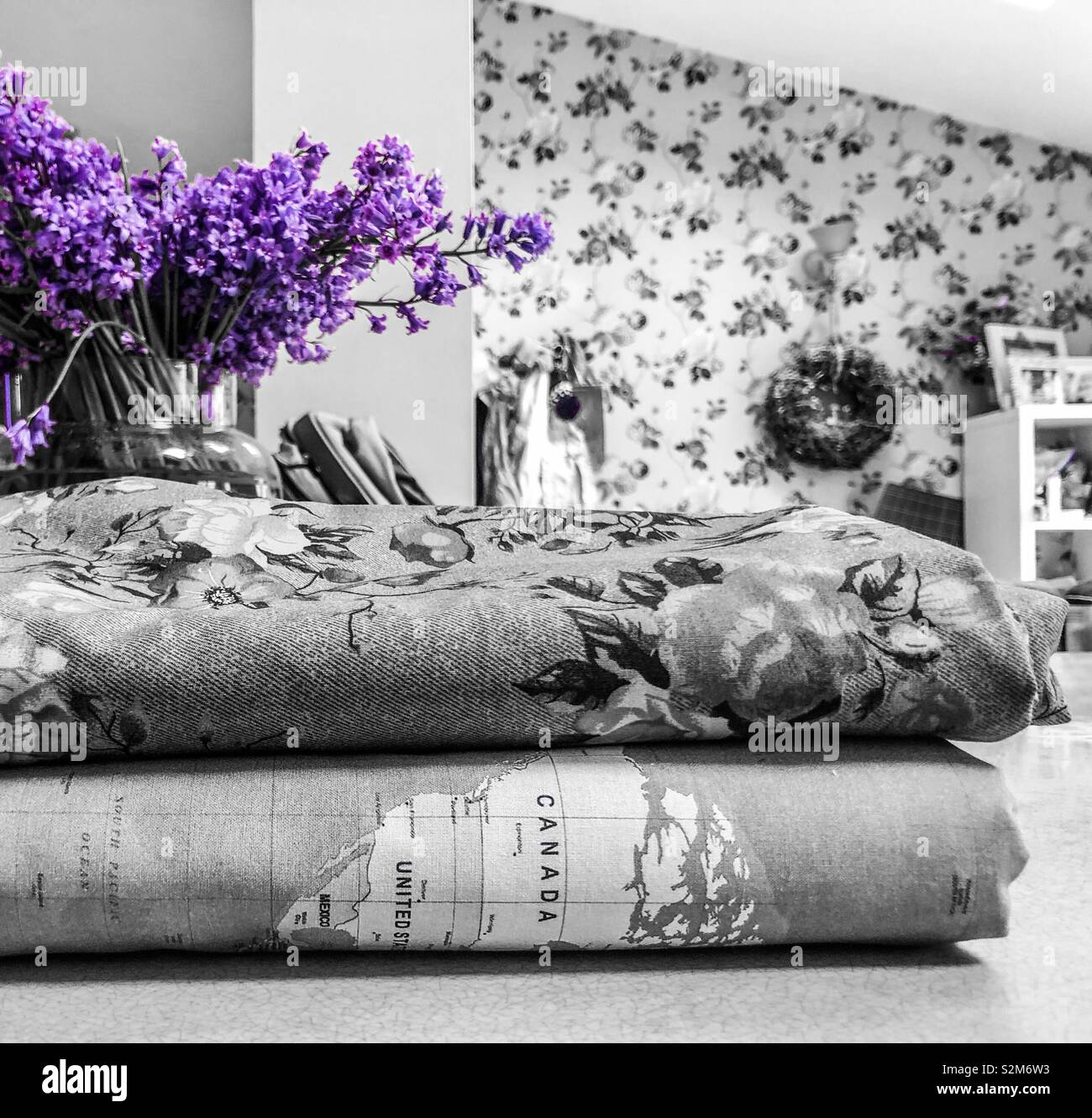 Fabric with bluebells in shabby chic kitchen - Stock Image