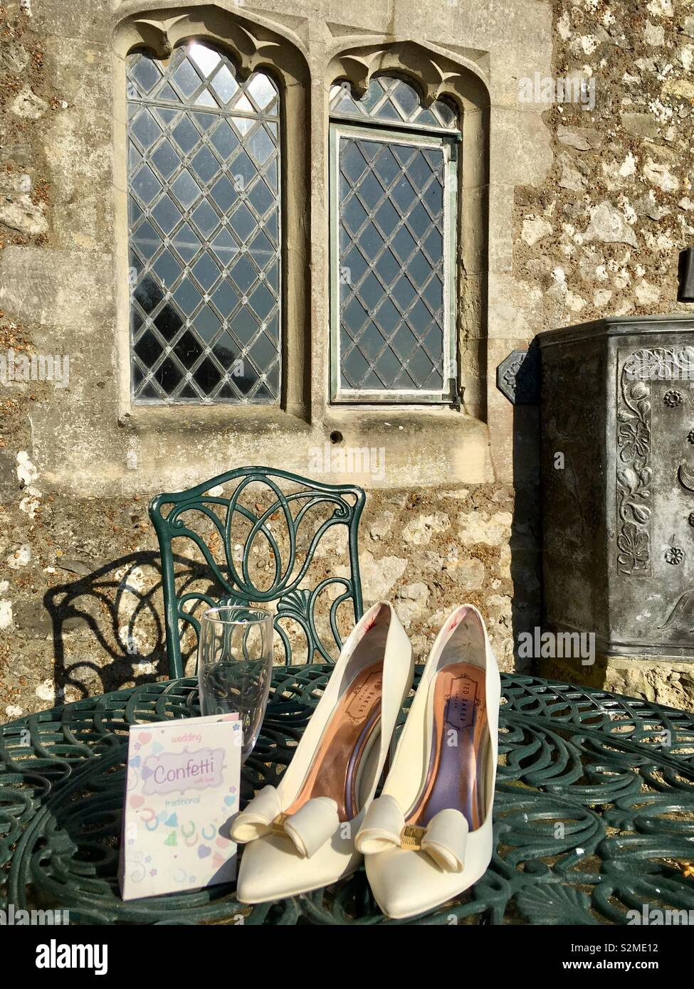 Wedding Shoes on a table in the sunshine Stock Photo