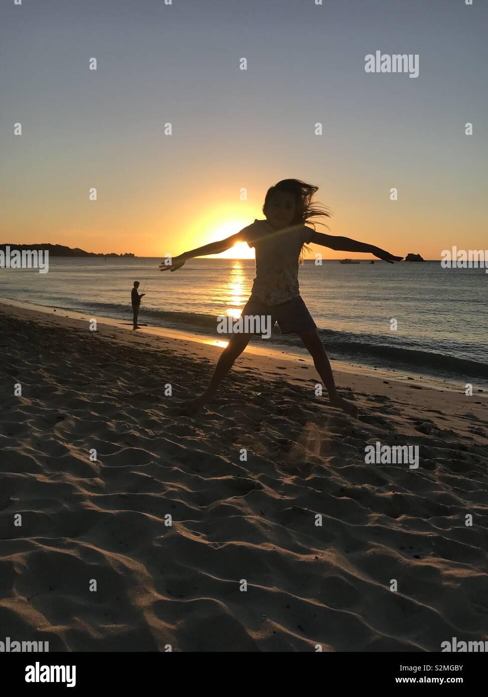 Star jump sunset - Stock Image