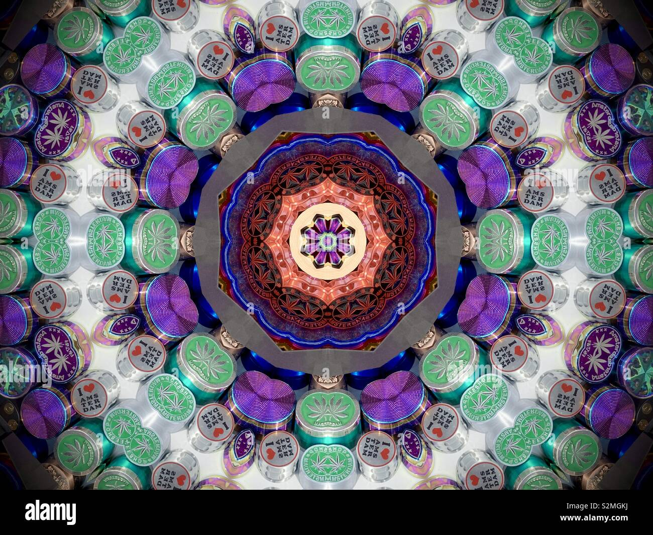 Kaleidoscope effect abstract image of cannabis tins in an Amsterdam shop window. April 2019. - Stock Image