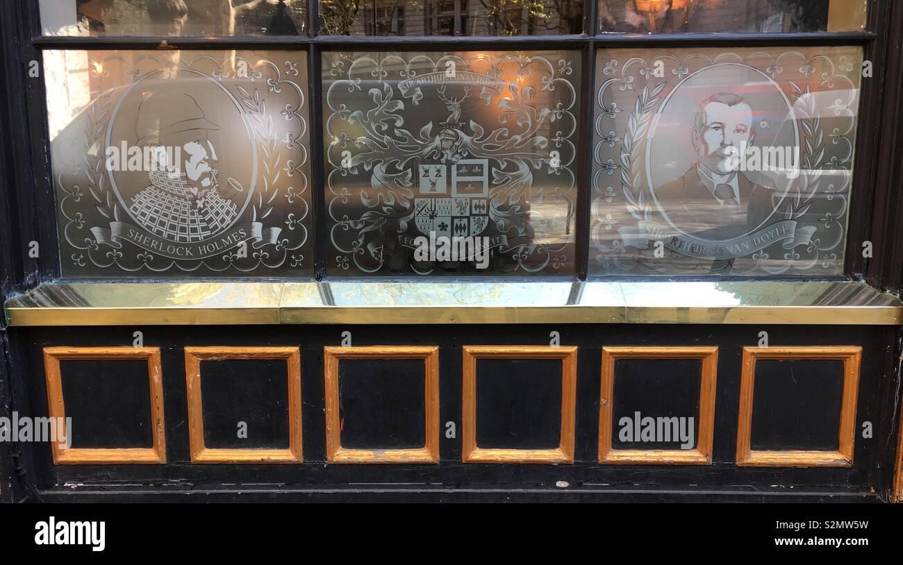 Sherlock Holmes and Sir Arthur Conan Doyle window at The Sherlock Holmes pub in Northumberland Street, London. - Stock Image