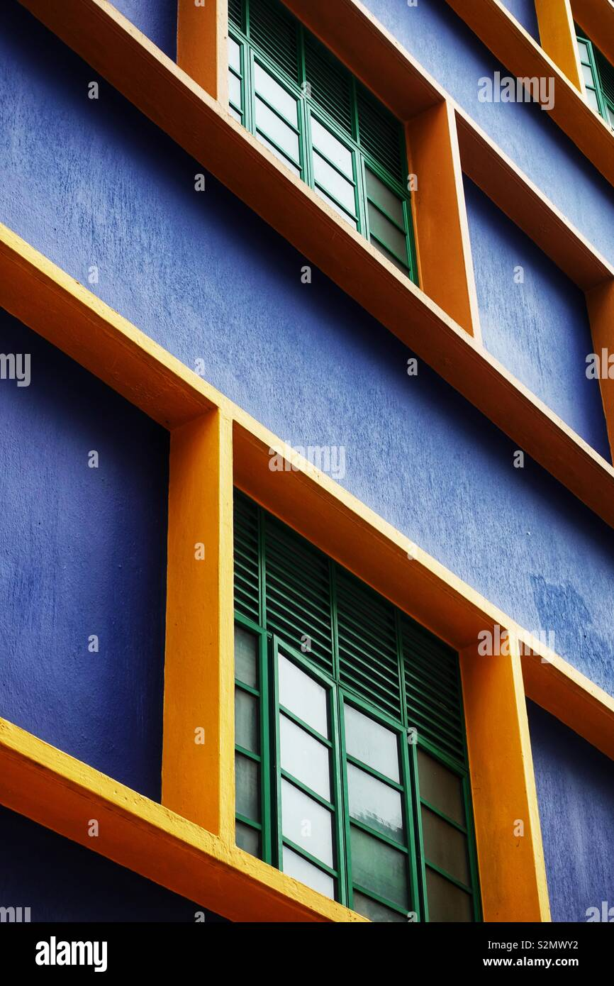 Close up of a ordinary but colorful facade in Singapur - structured, geometric, clear lines. Stock Photo