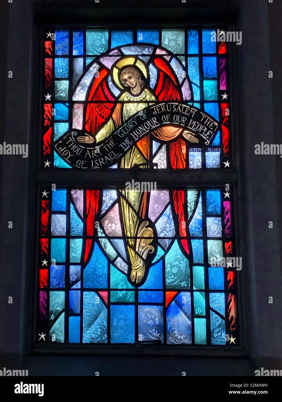 Stained Glass New Orleans.Stained Glass Image Of Angel Holding Banner Honoring Jesus