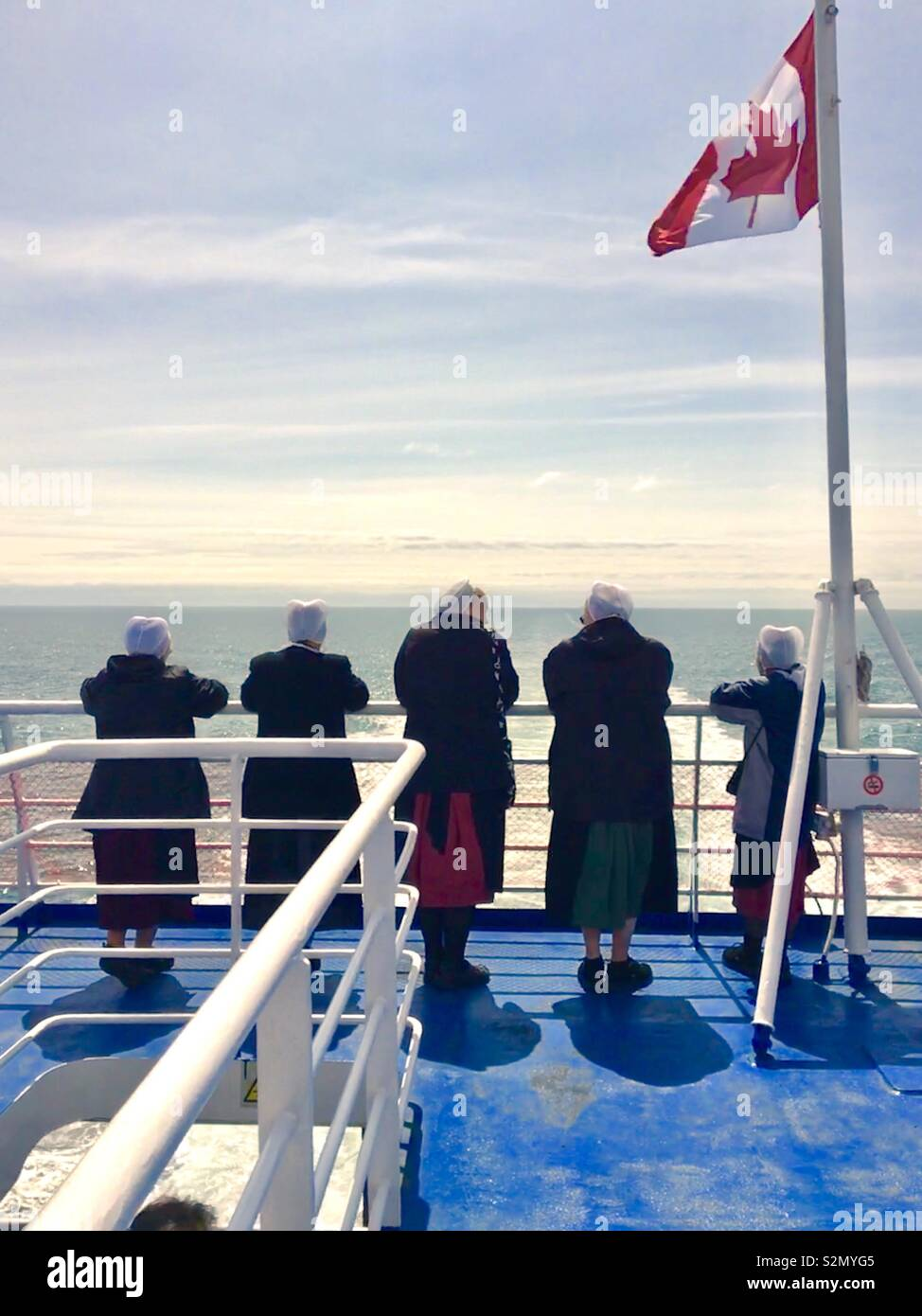 Amish women on a ferry in Canada Stock Photo
