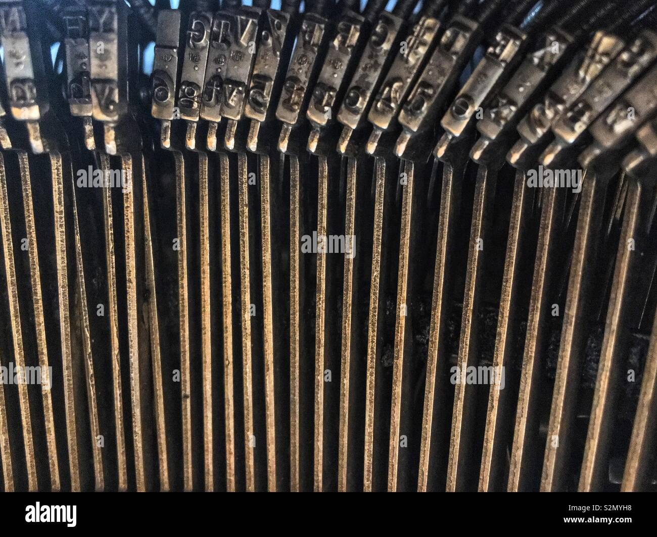 Closeup of the letter printing keys on an antique typewriter. - Stock Image