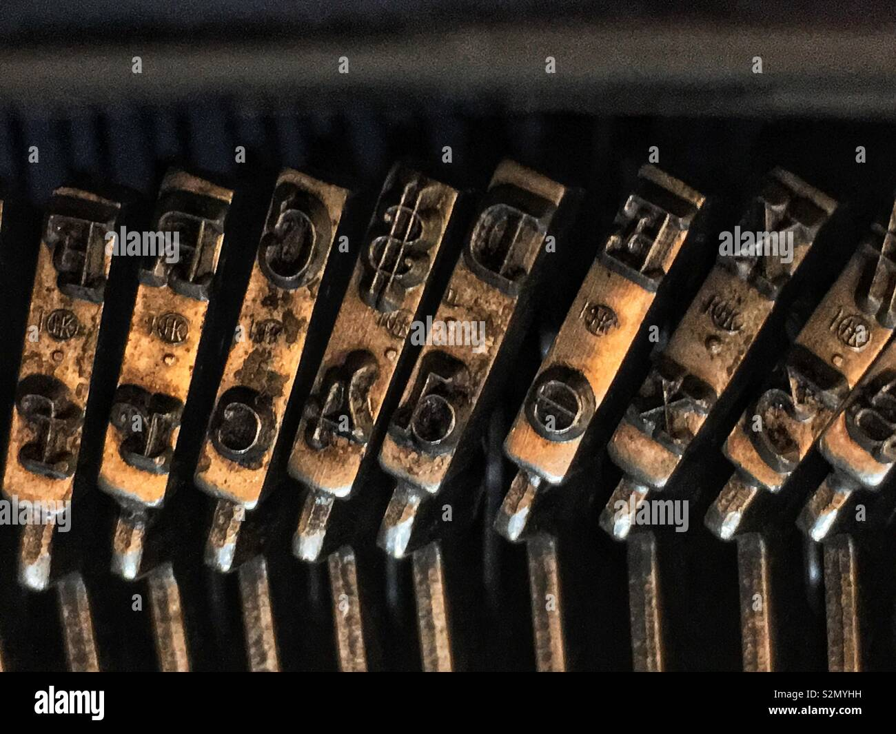Closeup of letter printing keys in an antique typewriter. - Stock Image