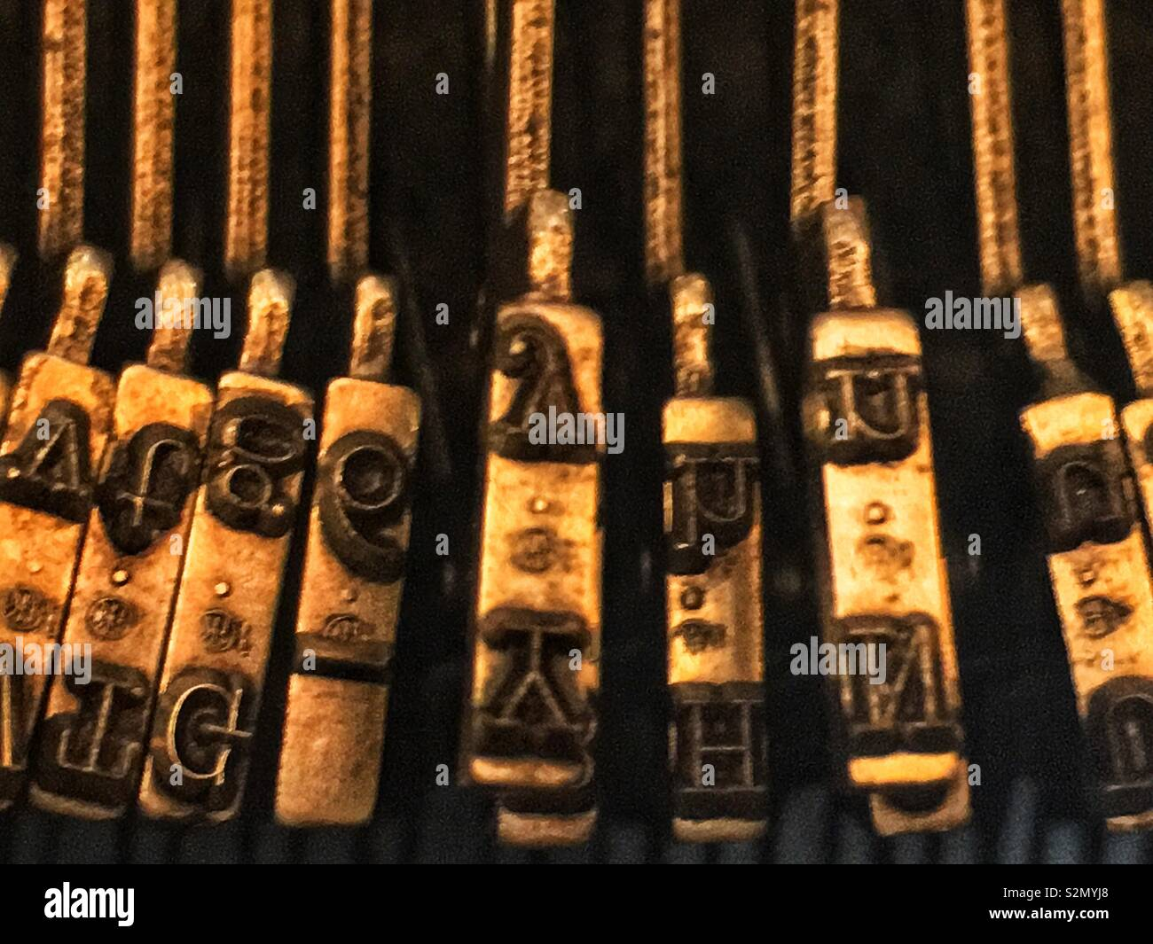 Soft focus Closeup of letter printing keys in an antique typewriter. - Stock Image