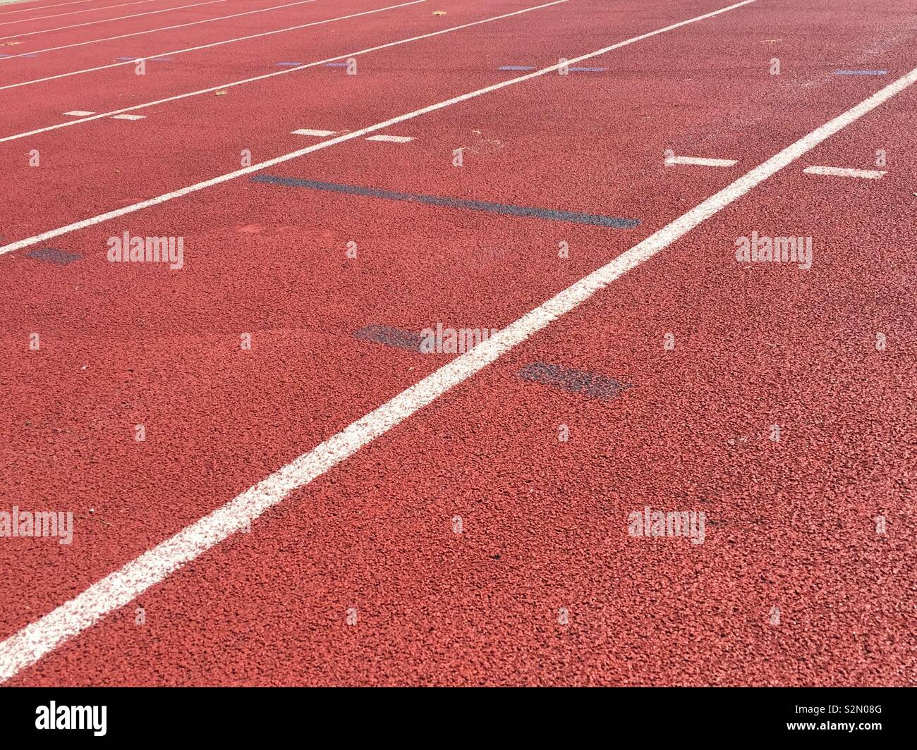 Red athletics track. Sports activities on a running track - Stock Image