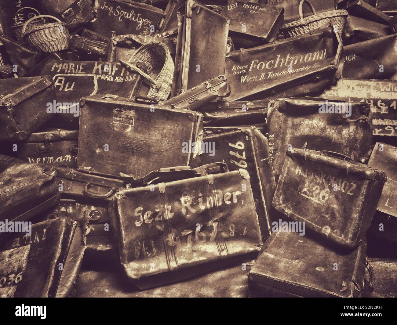 One of the exhibits at the Nazi Auschwitz Concentration Camp in Poland. These suitcases were confiscated from mostly Jewish people who were deported to Auschwitz. Most inmates were executed or gassed. - Stock Image