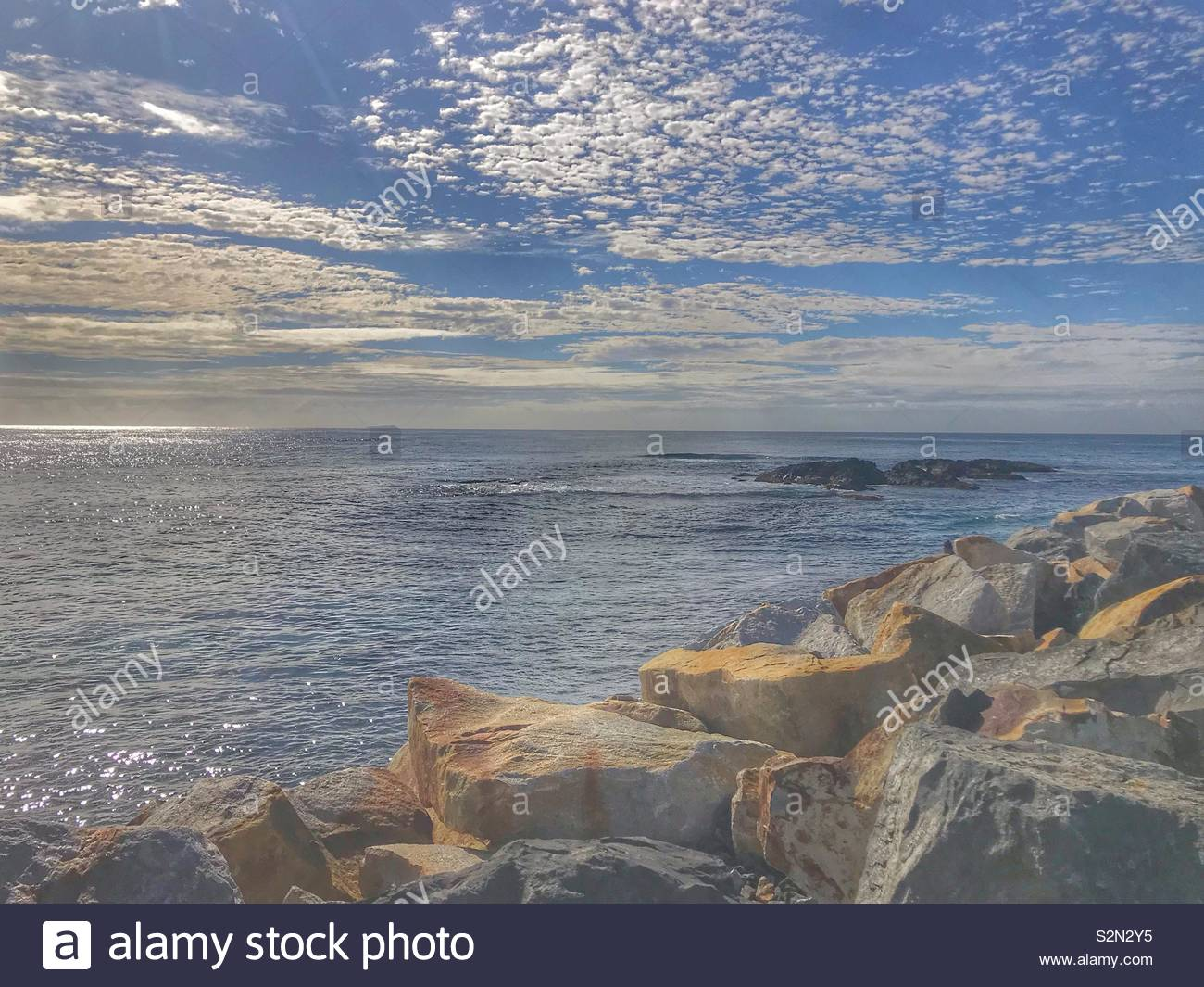 Dappled clouds on blue sky above Pacific Ocean from East coast of Australia - Stock Image