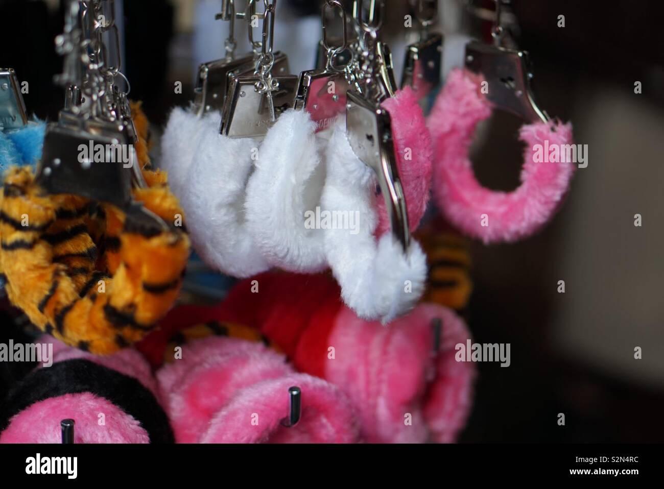 Fluffy Handcuffs for sale, Camden Market (London) - Stock Image