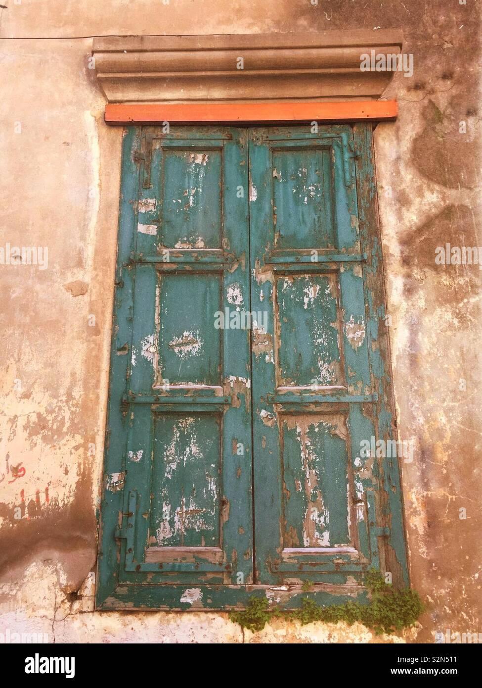 Derelict window shutters - Stock Image
