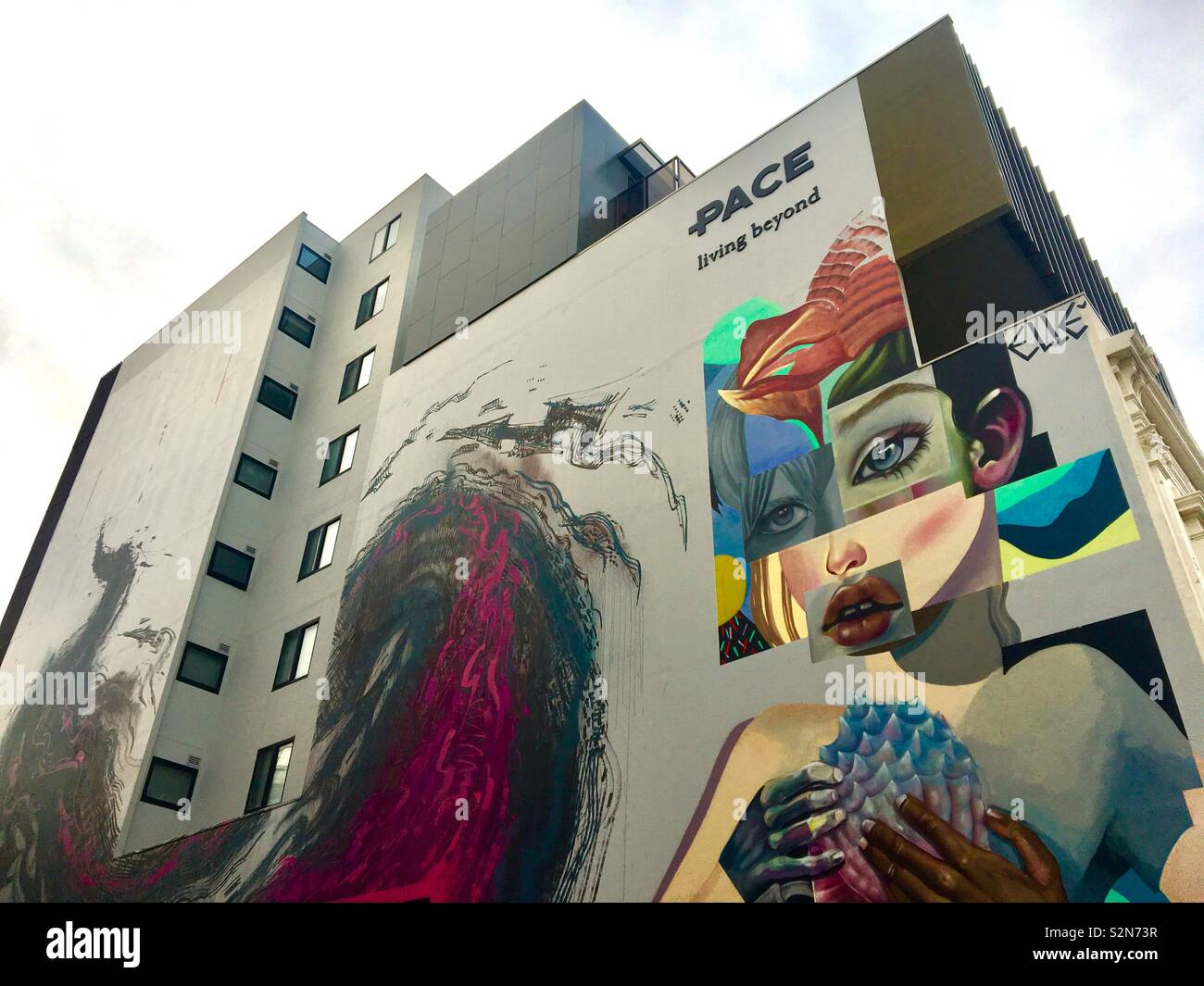 High rise apartments with street art mural Stock Photo
