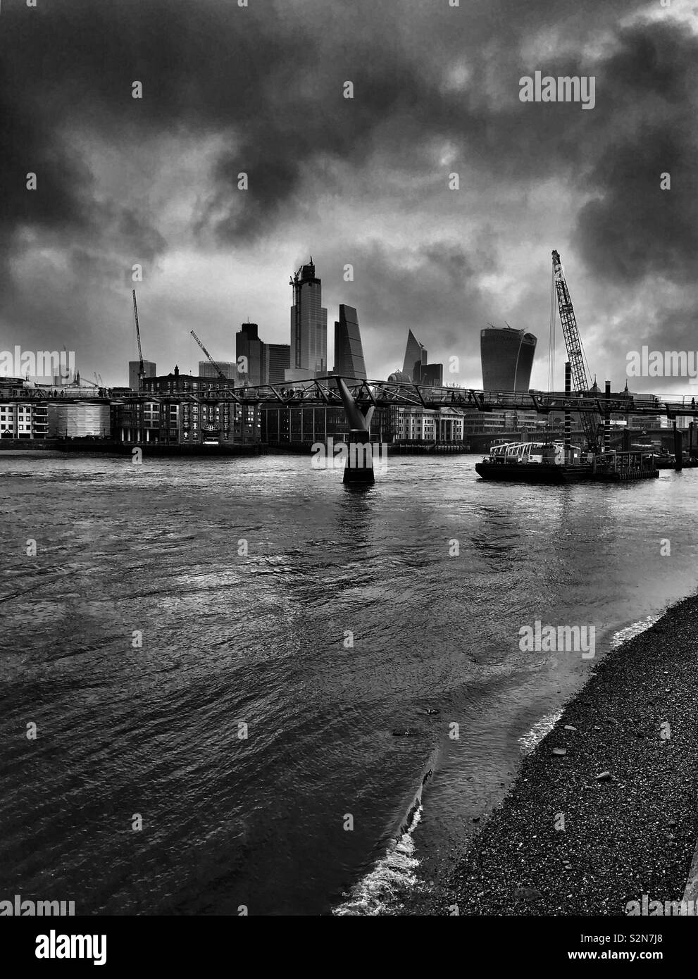 London skyline and dramatic clouds above the river Thames - Stock Image