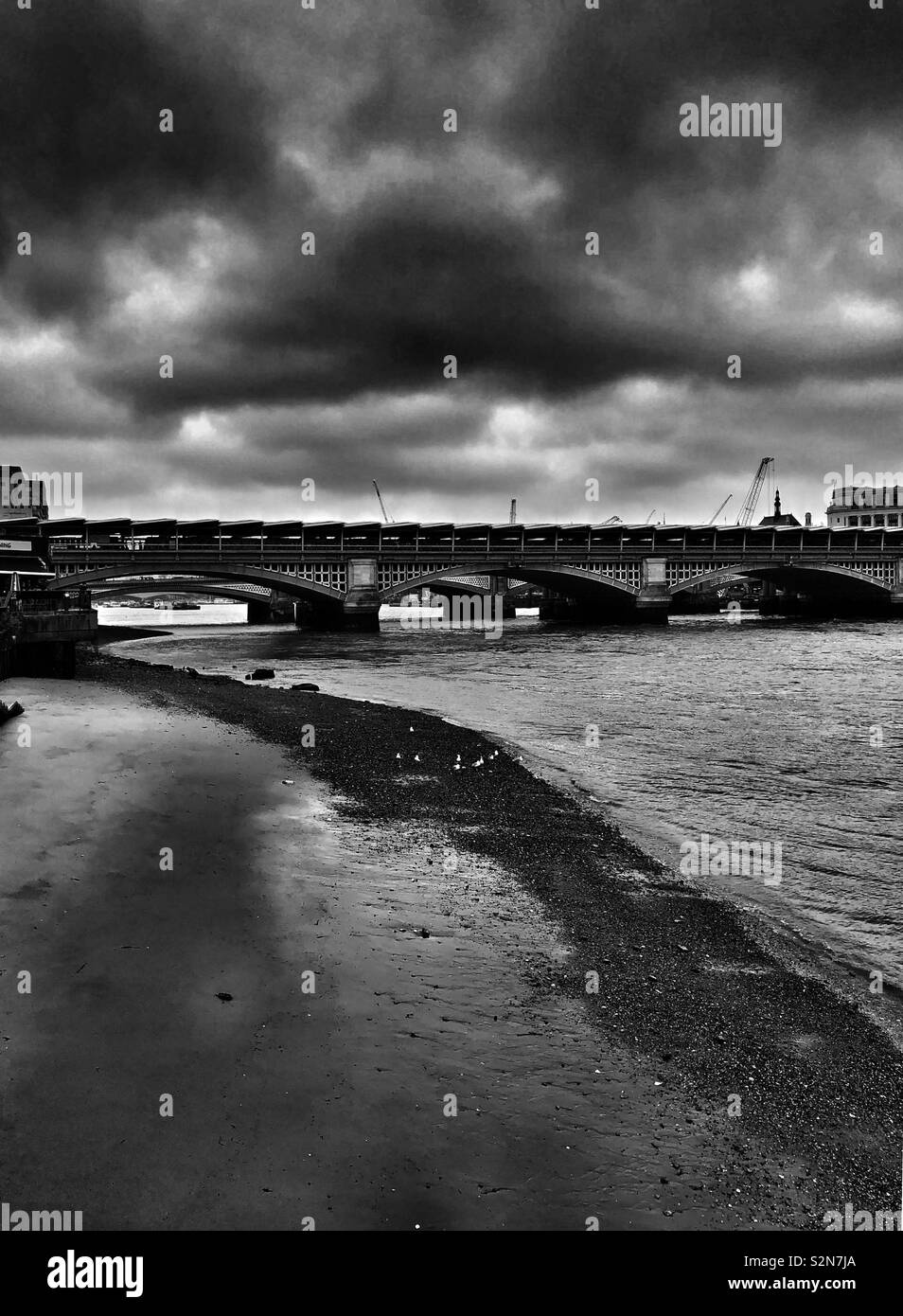 Dramatic clouds over the Blackfriars Bridge in London - Stock Image