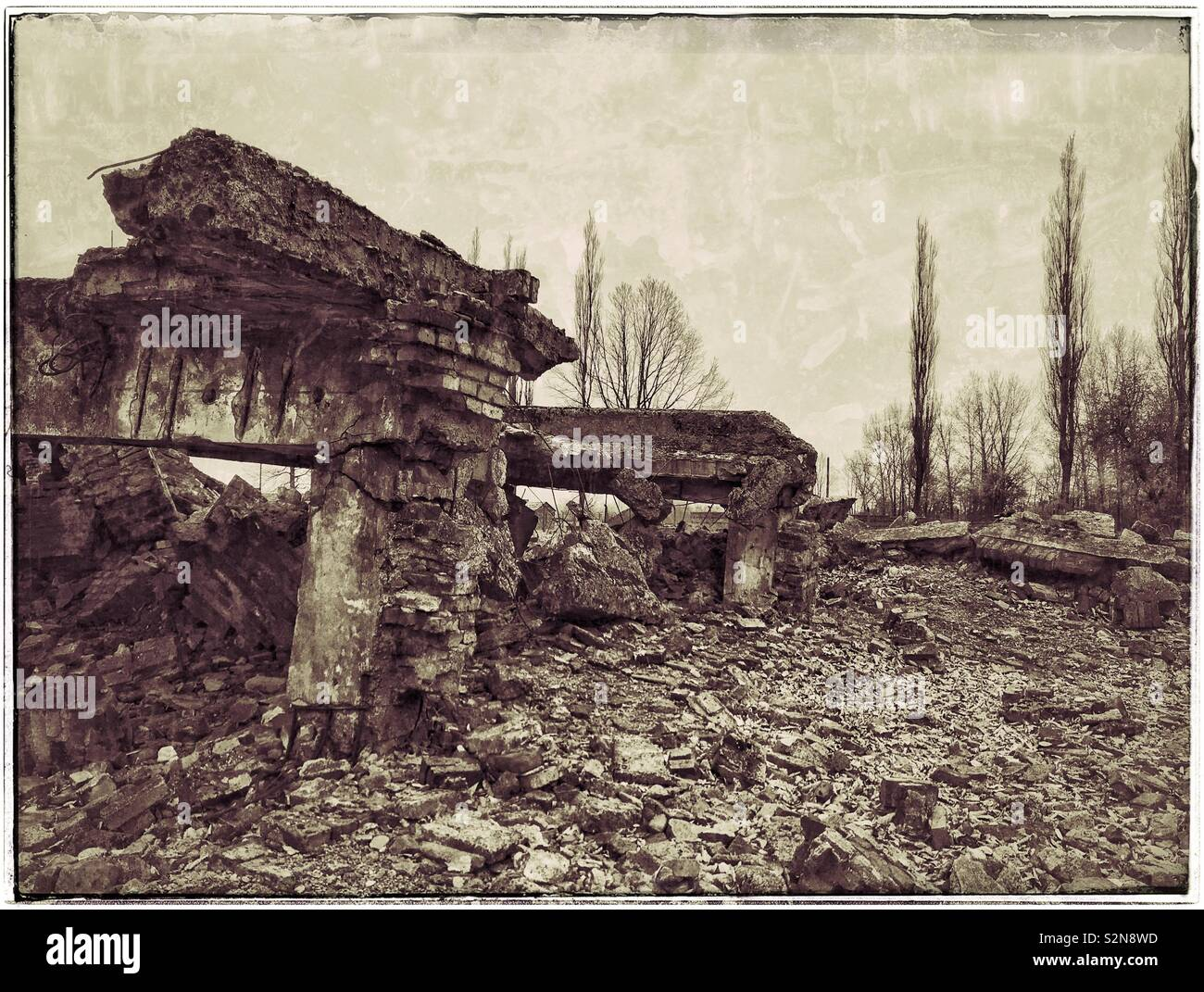 A retro effect image showing what remains of the infamous Gas chamber at the Nazi Auschwitz II-Birkenau Concentration Camp. Destroyed by the Nazis shortly before liberation by Soviet forces in 1945. Stock Photo
