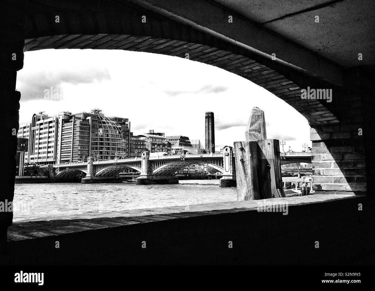 View along the River Thames looking towards Southwark bridge and the Southbank, London, England. - Stock Image