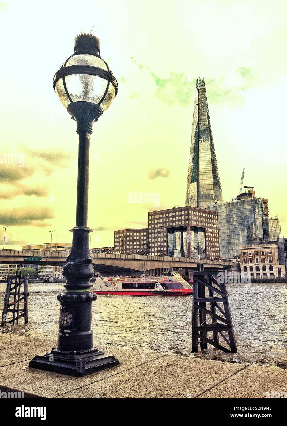 View across the River Thames in London, England, looking towards London Bridge and the Shard. Stock Photo