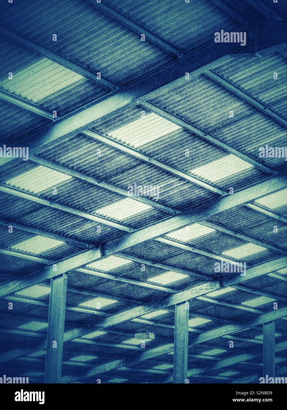 Roof of large agricultural building. - Stock Image