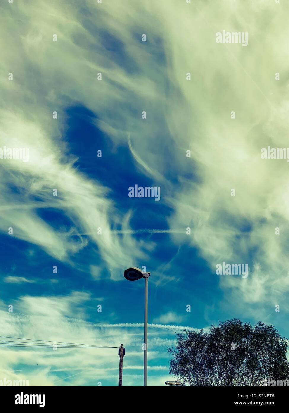 CCTV on a wispy cloud sky - Stock Image