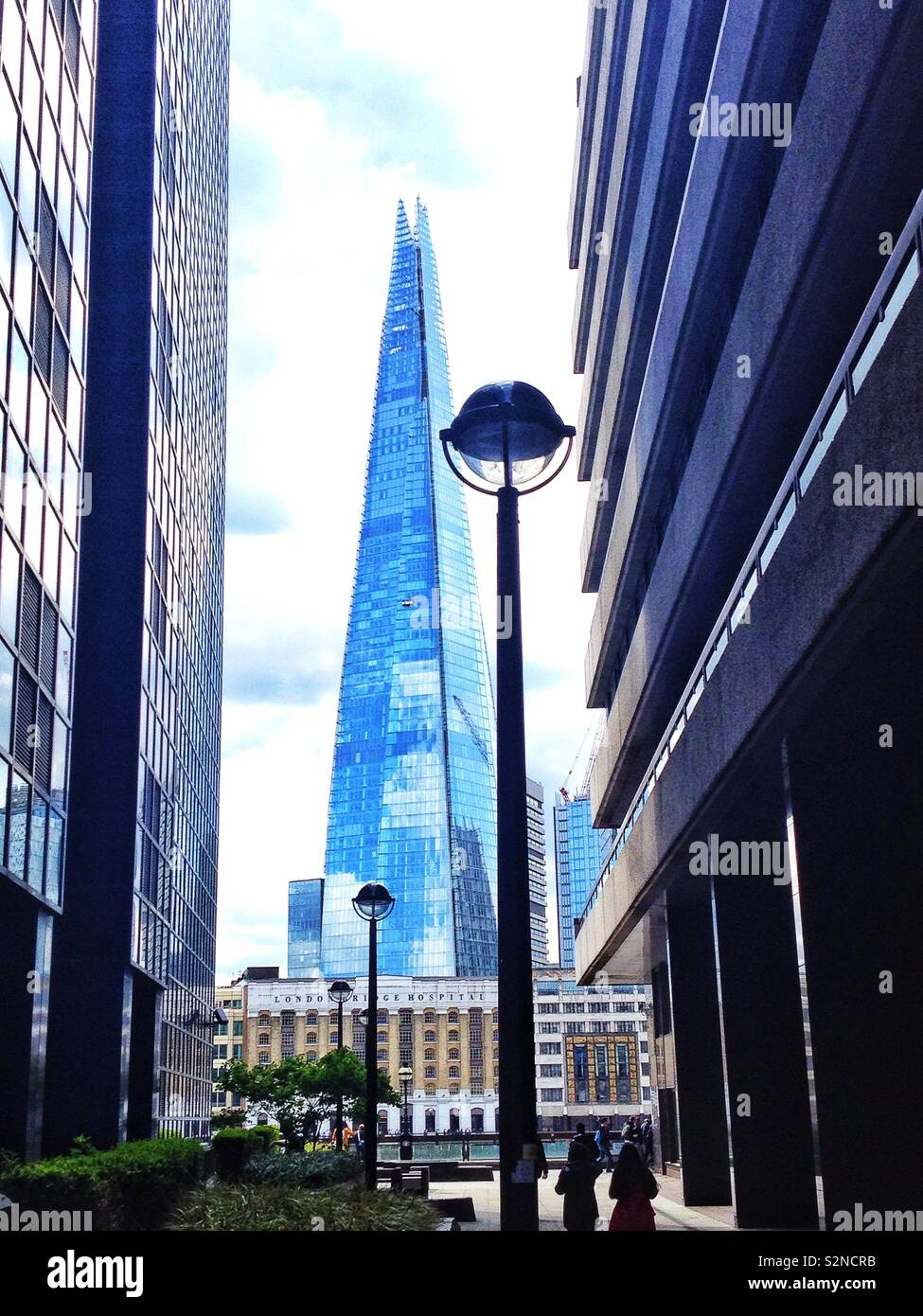A view of the glass Shard building viewed from a narrow side street on the north bank of the River Thames in London, England. Stock Photo
