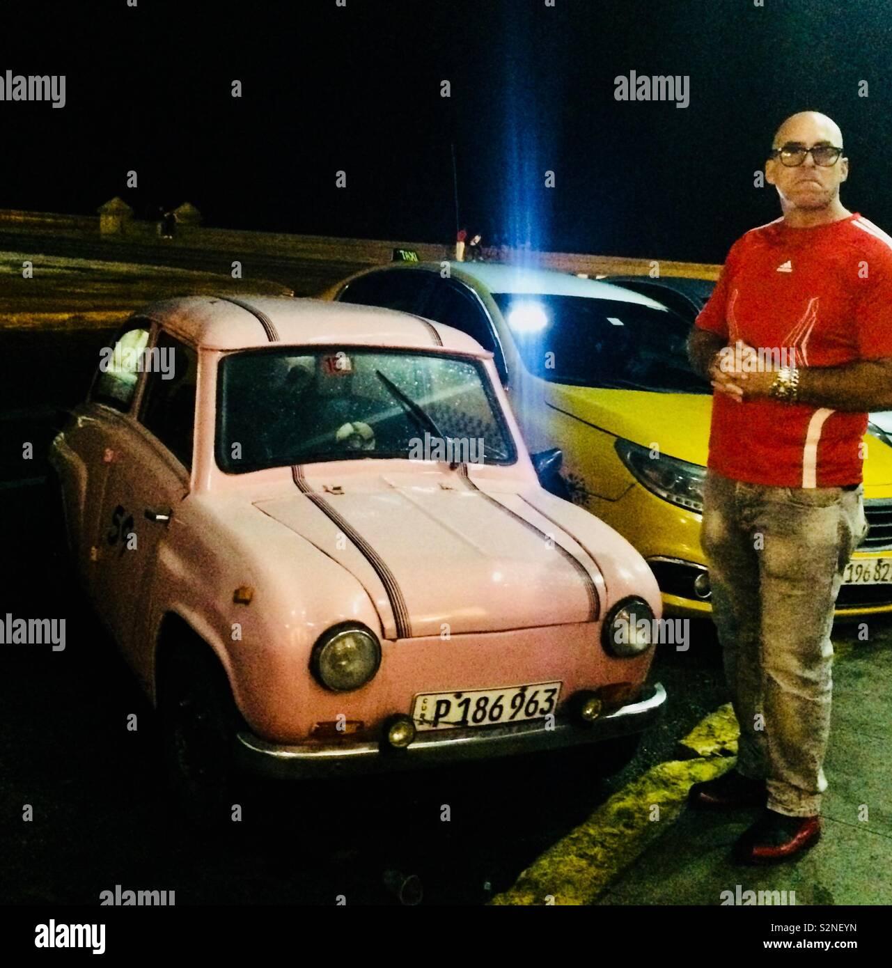 A tiny pink car in Havana Stock Photo