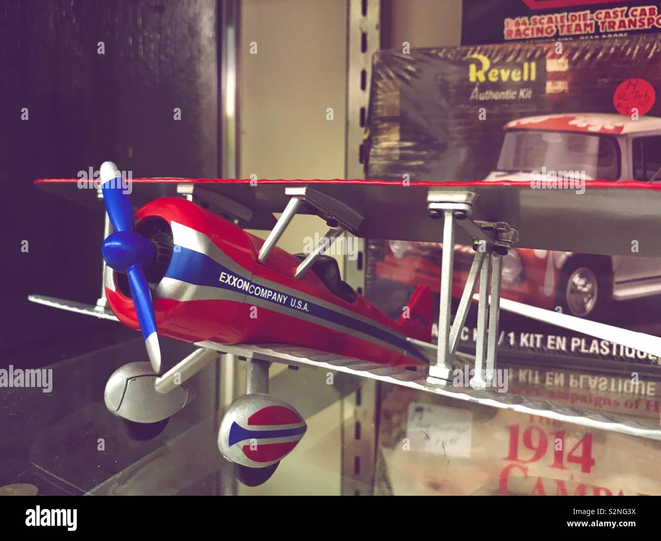 Bright red and blue model airplane on display in flea mall - Stock Image
