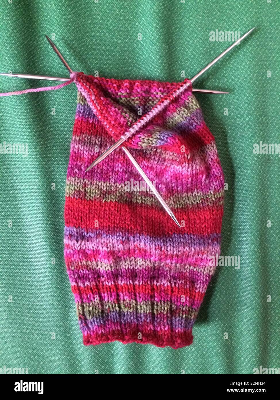 A Sock Or Sleeve Being Knitted In The Round On Double Pointed