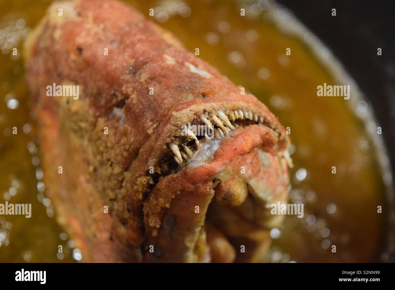Whole fish head fried to perfection! Stock Photo