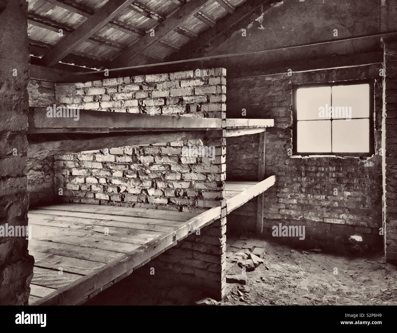 A place of horrific suffering-sleeping quarters of Jewish prisoners at the Nazi Auschwitz II - Birkenau Concentration Camp near Oswiecim in Poland. Thousands of people perished here. © COLIN HOSKINS. - Stock Image