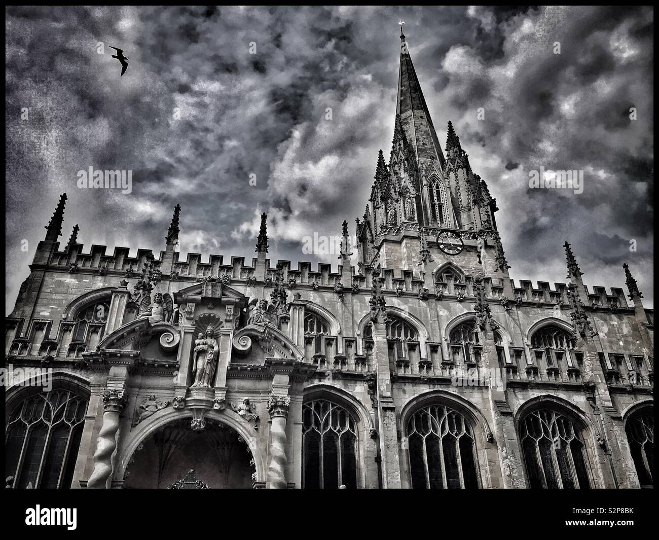 A moody image of the University Church Of St. Mary the Virgin in Oxford, England. This parish church has much history and is deeply connected to Oxford University. Photo © COLIN HOSKINS. - Stock Image