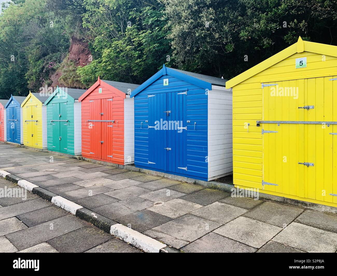 Colourful beach huts in Dawlish - Stock Image