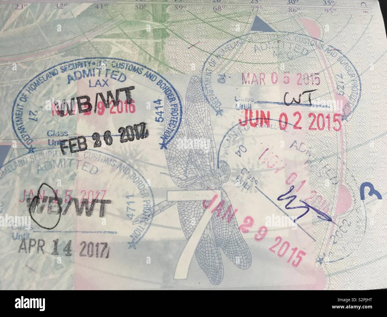 Passport visa page with stamps - Stock Image