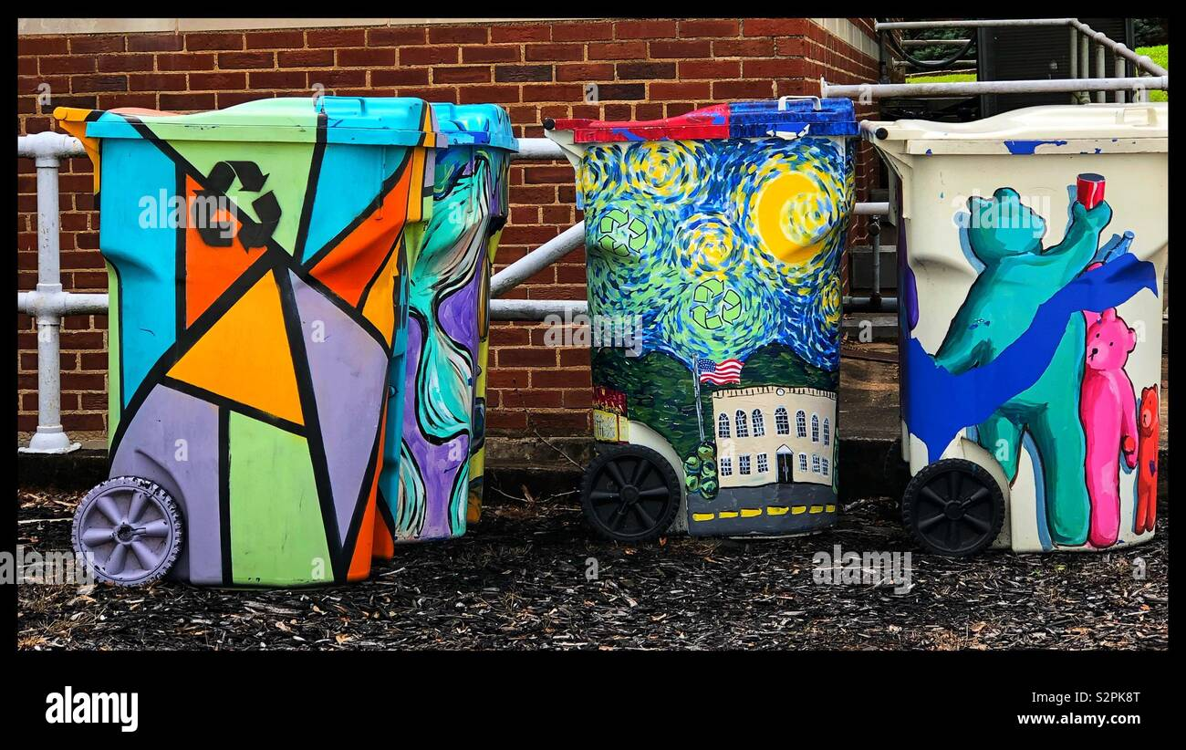 Handpainted trash cans - Stock Image