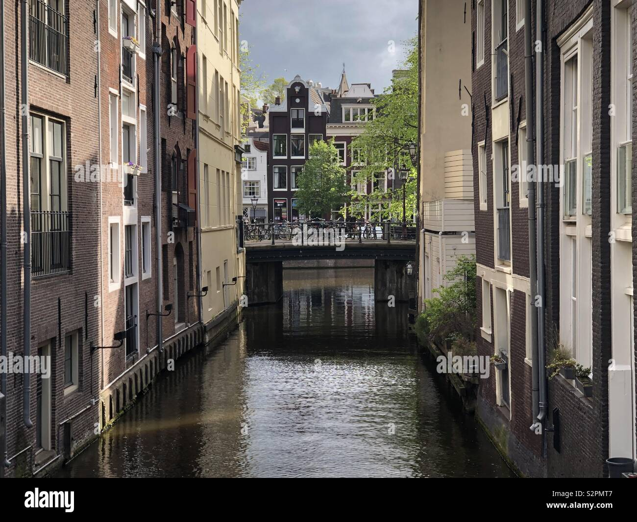Small bridge over canal in Amsterdam. - Stock Image