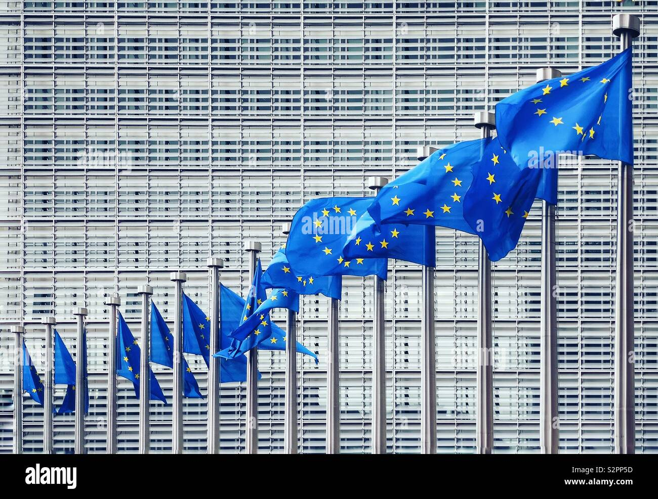 European Union flags flying in front of the European Commission building,Brussels - Stock Image